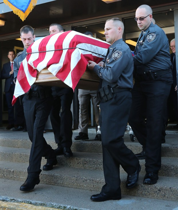 Rusk County deputies carried the casket of Rusk County Deputy Sheriff Dan Glaze Jr. after a service, Friday, Nov. 4, 2016 at the former Cameron Elementary School in Cameron, Wis. Douglas Nitek is accused of killing Glaze Saturday night, Oct. 29, as the officer investigated a report of a suspicious vehicle in a field several miles from the suspect's residence near Ladysmith, about 130 miles northeast of Minneapolis. (Dan Reiland/The Eau Claire Leader-Telegram via AP) MANDATORY CREDIT