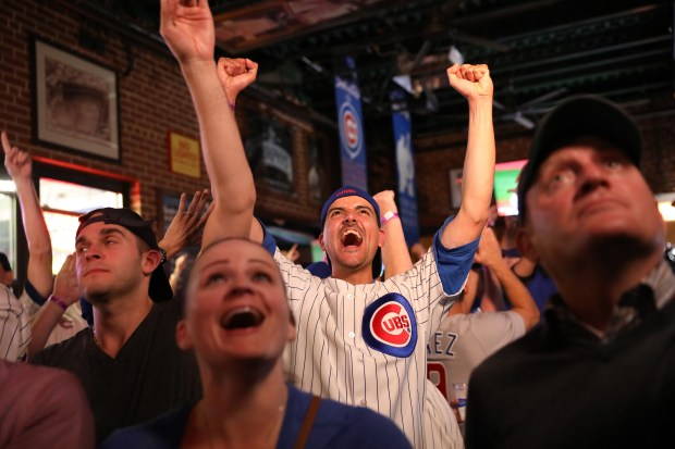 Henry Zabala from Skokie at Murphy's Bleachers celebrates a pick off while watching the Cubs win Game 7 of the World Series on Nov. 2, 2016 in Chicago. (Nancy Stone/Chicago Tribune/TNS)