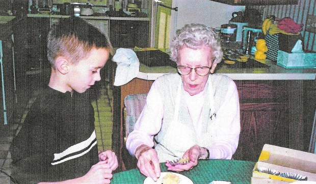 Ardis Thomas teaches grandson Bryan Herbert how to make sandbakkelse, a Norweigan sugar cookie. (Courtesy of Cathie Sharkey)