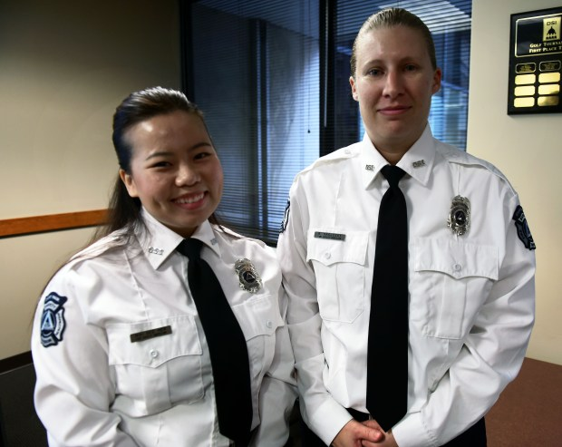 Mai See Her, left, and Sara Naglosky were sworn in as St. Paul fire inspectors with the city's Department of Safety and Inspections, Tuesday, November 22, 2016.  (Pioneer Press: Scott Takushi)