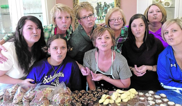 Gathered to make Party Crackers are, front row, from left, Rebekah Kolstad, Anna Marie Brick, Cassie Wright and Annie Jessop. Back row, from left, are Megan Wright, Teresa Kolstad, Patty Jessop, Mary Wright and Allyson Marco. (Courtesy of Anna Marie Brick)