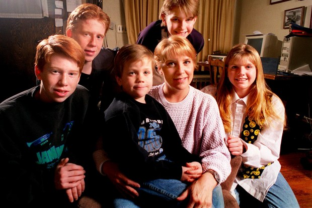 Felicia Reilly is shown in a Jan. 1997 photo surrounded by her children, from left, Ben, 14, Matt, 17, Zachary, 7, Marianne, 13, and Theresa, 14. Reilly was among the 40 new officers who graduated from the St. Paul Police Academy on Jan. 9, 1997. Reilly wanted to be a police officer when she was 19 years old but took a career detour to raise a family with her husband, a St. Louis Park police officer. (Pioneer Press: Scott Takushi)
