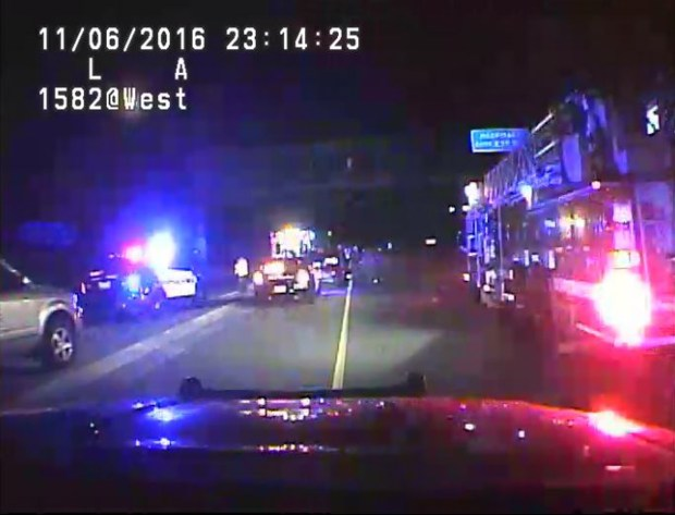 A screengrab from a St. Paul police squad camera when officers, firefighters and others came to assist a St. Paul woman who delivered her baby in a vehicle pulled over on Interstate 94 on Sunday, Nov. 6, 2016. (Courtesy St. Paul police department)