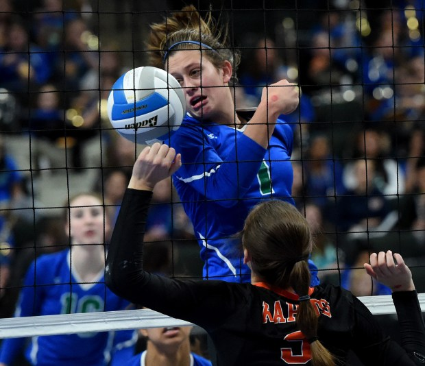Eagan's McKenna Melville, top, couldn't block the ball hit by Grand Rapids's Megan Walsh in the quarterfinals of the State Class AAA volleyball tournament at Xcel Energy Center in St. Paul on Thursday, Nov. 10, 2016. (Pioneer Press: Jean Pieri)