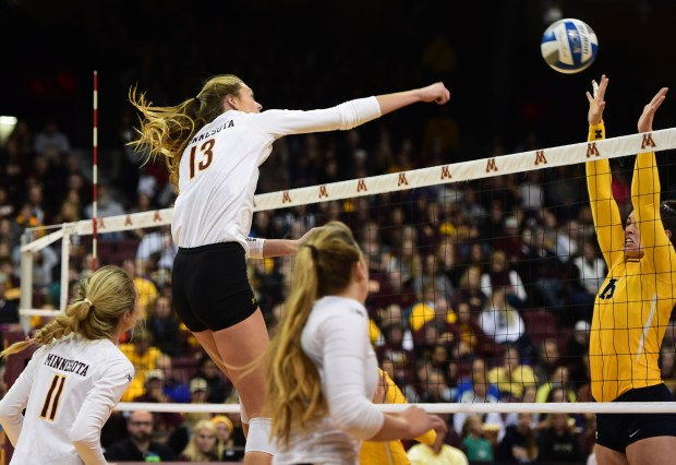 Minnesota's Molly Lohman spikes the ball during the Gophers' five-set victory over Michigan hers Volleyball beat the Michigan Sunday at the Sports Pavilion (Pioneer Press: Scott Takushi)