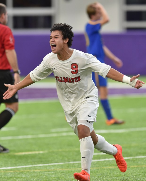 Stillwater Ponies forward Jorge Malon celebrates a Ponies corner kick goal by midfielder Kohei Adams against the Wayzata Trojans during the second half of the Class 2A championship game of the State Boys Soccer Tournament at U.S. Bank Stadium in Minneapolis on Thursday, Nov. 3, 2016. Stillwater beat Wayzata, 2-0 to claim the state title. (Pioneer Press: John Autey)