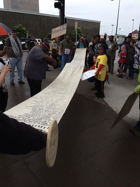 """Communities United Against Police Brutality has been recording the names of people killed by police on a """"Stolen Lives"""" scroll since 2000. The document also contains some names of people who died in earlier years. (Courtesy Corydon Nilsson)"""