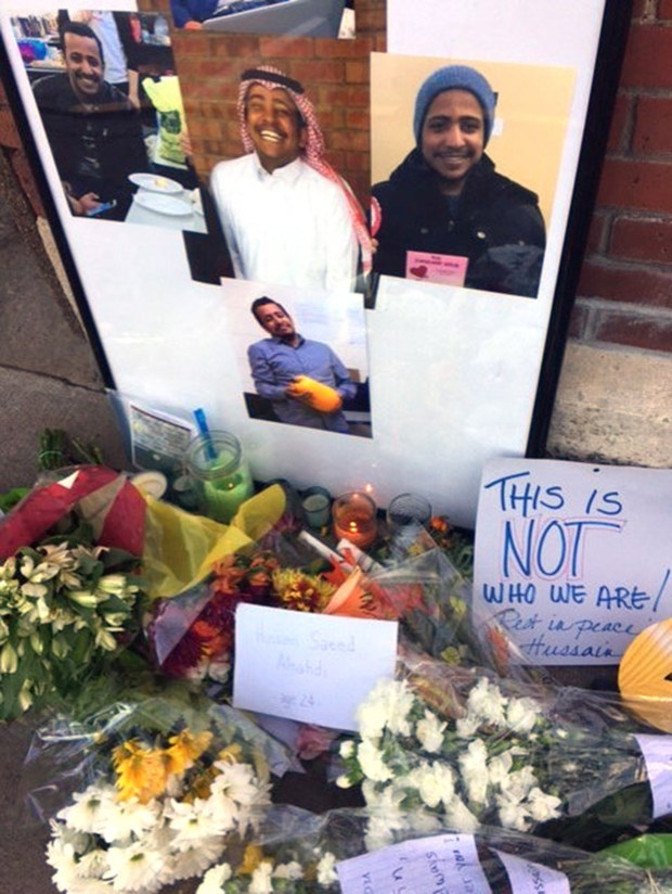 Photos are placed at the memorial for Hussain Saeed Alnahdi, 24, who died Monday, one day after being assaulted on a street in downtown Menomonie. (Karen Herzog/Milwaukee Journal Sentinel/TNS)