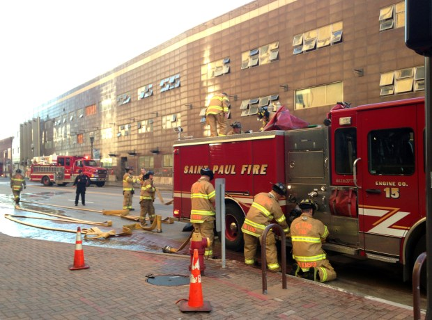 St. Paul firefighters clean up after responding to a fire Tuesday morning, Nov. 1, 2016, at the former West Publishing headquarters on Kellogg Boulevard. The building is vacant and being demolished. (Pioneer Press: Jaime DeLage)
