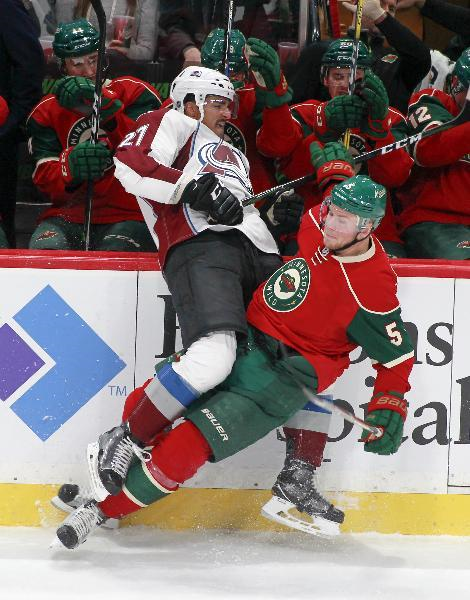 Minnesota Wild defenseman Christian Folin, of Sweden (5) collides with Colorado Avalanche left wing Andreas Martinsen, of Norway (27) along the boards during the first period of an NHL hockey game, Saturday, Nov. 19, 2016, in St. Paul, Minn. Colorado won 3-2. (AP Photo/Paul Battaglia)