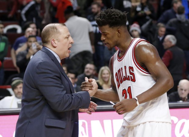 Minnesota Timberwolves head coach Tom Thibodeau, left, shakes hands with his former player Chicago Bulls' Jimmy Butler after an NBA basketball game Tuesday, Dec. 13, 2016, in Chicago. The Timberwolves won 99-94. (AP Photo/Charles Rex Arbogast)