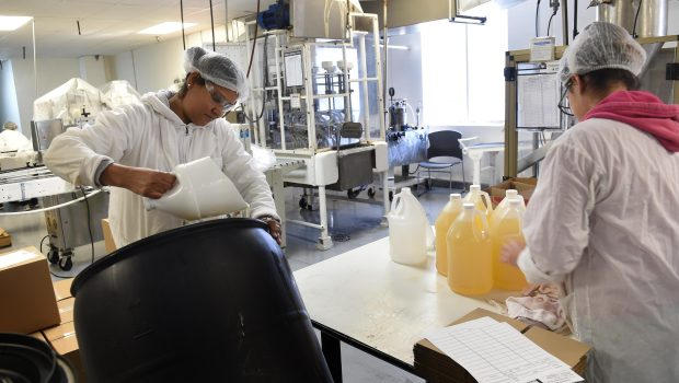 Camillea Anthoney, left, and Lurvin Vargas fill bottles with shampoo at Diversified Manufacturing Corp. in Newport, Minn., Wednesday, Dec. 14, 2016. (Pioneer Press: Scott Takushi)