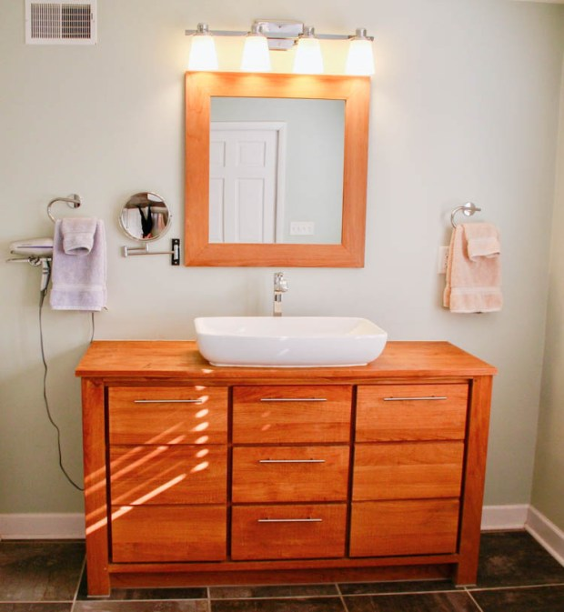 We decided to make this Venica teak vanity with matching mirror and Garradd vessel sink the centerpiece of our minimalist bathroom, accented with chrome accessories including a Hansgrohe faucet and Linea di Liara vanity sconce lamp.