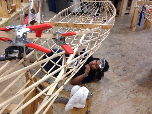Boat bulder Anthony Williams sanding a canoe frame in the Urban Boatbuilders shop. (Richard Chin)