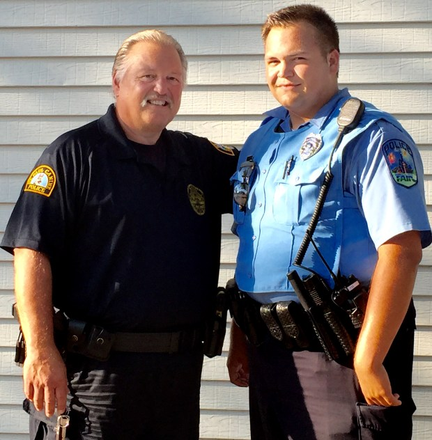 Dave Longbehn Jr., right, is following in the footsteps of his father, Dave Longbehn, and becoming a St. Paul police officer on Thursday, Dec. 15, 2016. They are pictured at the Minnesota State Fair in 2015, where Longbehn Jr. was a State Fair police officer. (Courtesy photo)