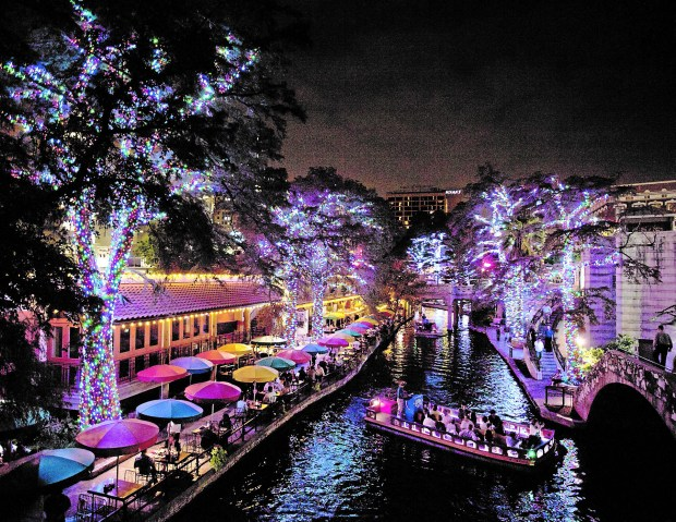 At Christmas time, the River Walk becomes even more colorful with millions of lights strung from the trees. (Courtesy of Darren Abate)