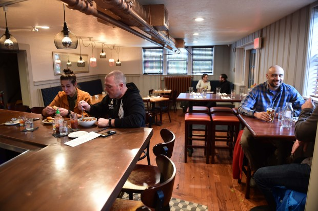From left: ShaNae Alkordi (egg sandwich) and Steve Makens (corned beef hash), both of Minneapolis, and Elo Alston (eggs benedict) of Robbinsdale by the window enjoy brunch at Stewart's, 128 Cleveland Avenue in St. Paul, Sunday, Nov. 27, 2016. (Pioneer Press: Scott Takushi)
