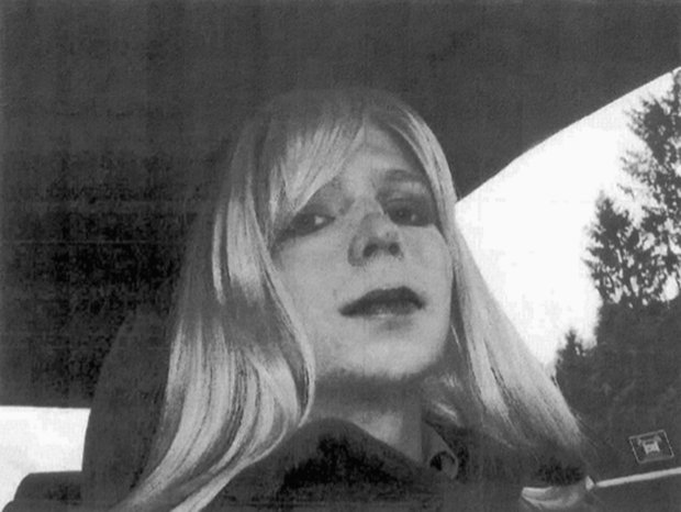 In this undated photo provided by the U.S. Army, Pfc. Chelsea Manning poses for a photo wearing a wig and lipstick. On Tuesday, Jan. 17, 2017, President Barack Obama commuted the sentence of Chelsea Manning, who leaked Army documents and is serving 35 years. (U.S. Army via AP)