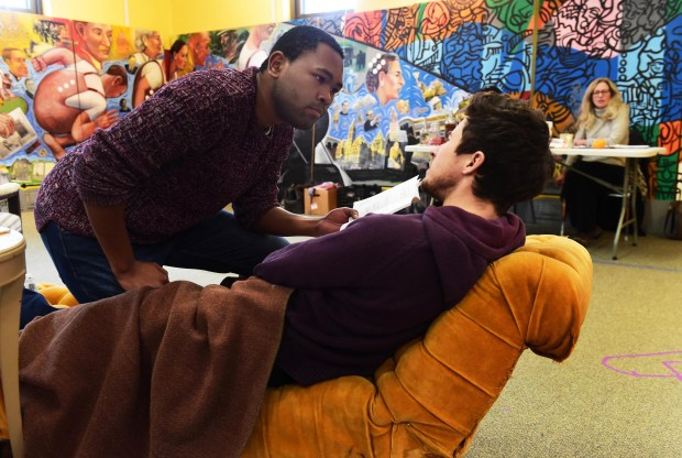"JuCoby Johnson, left, and Riley O'Toole rehearse a scene from ""The Whipping Man"" directed by Sally Wingert, at East Side Freedom Library in St. Paul Monday, January 16, 2017 in St. Paul. (Pioneer Press: Scott Takushi)"