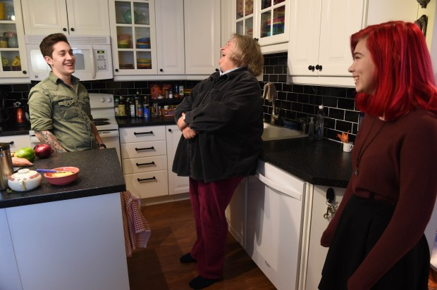 Mystery writer Ellen Hart chats with two of her five grandchildren at her home in Eden Prairie, Dec. 21, 2016. From left: Avery Kruger-Williams, Hart, Mirabel Gibson (Pioneer Press: Scott Takushi)