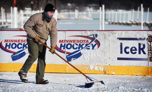 Volunteer Jeff Cates of Stillwater helps clear snow from the rink as work continues Thursday, Jan. 12, 2017, on the outdoor rink for Hockey Day Minnesota in Stillwater. Cates' son Noah is on the Stillwater Area High School varsity hockey team. (Pioneer Press: Jean Pieri)