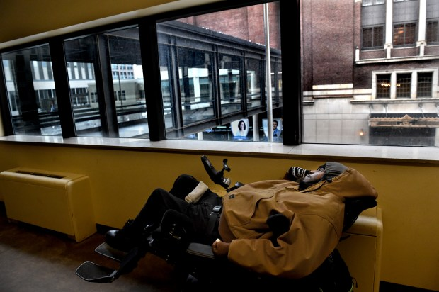 Mark Webb takes a break in the skyway across from the old Pioneer Press building in St. Paul on Wednesday, Jan. 25, 2017. He stays in a care facility and was resting before going back there. He said he is in a wheelchair because he was shot in Tennessee in 2015 and the bullet hit his spinal chord, paralyzing him. He came to Minnesota for better care and because he has a child here. (Pioneer Press: Jean Pieri)