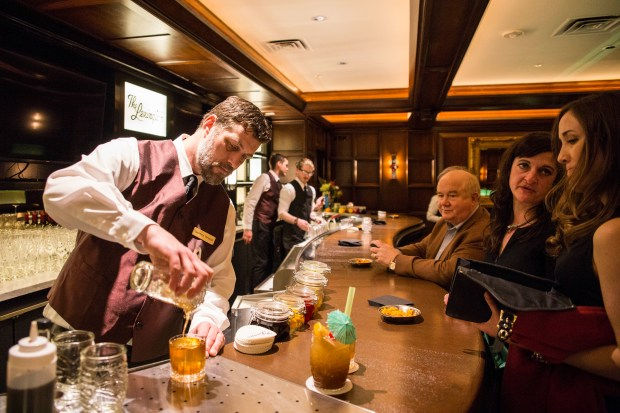 Bar manager Geoffrey Lee Trelstad serves up cocktails at The Lexington in St. Paul during a private event that the restaurant hosted on Saturday evening, Jan. 21, 2017. (Special to the Pioneer Press: Liam James Doyle)