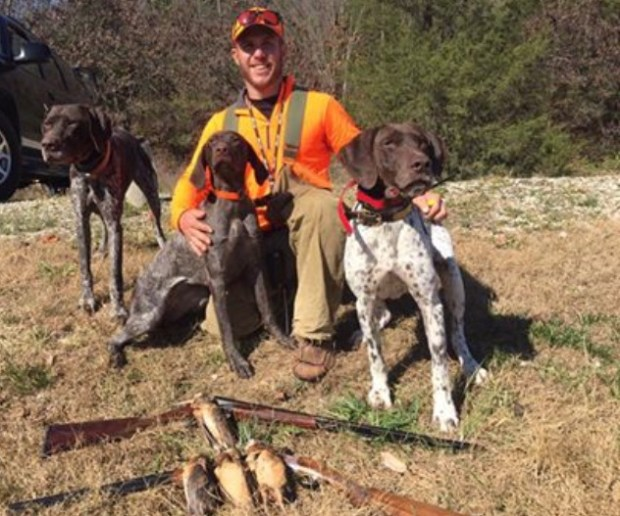 Hunting guide Patrick Flanagan is pictured with his dogs, from left, Eclectic Nomad, High-end Hunter and Dreamy. (Photo courtesy Patrick Flanagan/Border to Border Outfitters)