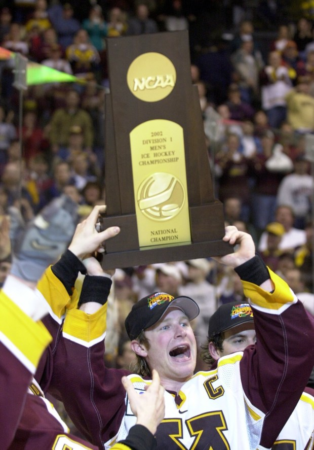 Gophers defenseman Jordan Leopold holds up the national championship trophy after Minnesota defeated Maine 4-3 in overtime in the 2002 national title game at Xcel Energy Center. (Pioneer Press file photo)