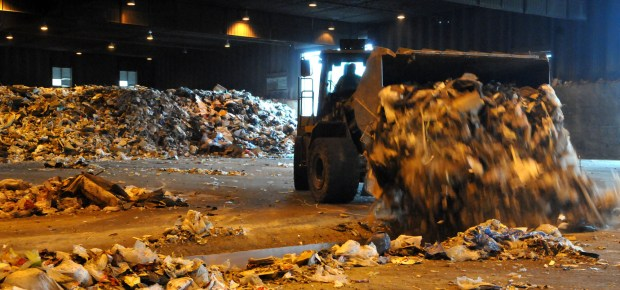 A front end loader deposits fresh garbage to the conveyor belt where it is sorted and will find itself on a truck to another destination Wednesday morning April 17,2013., The Resource Recovery Technology plant in Newport sorts garbage into flammable--and trucks it to power plants in Red Wing and Mankato to burn for power. (Pioneer Press: John Doman)