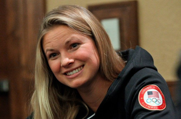 Cross-country skier Jessie Diggins speaks with reporters during a news conference at the U.S. Olympic Committee media summit Wednesday, Oct. 2, 2013, in Park City, Utah. (AP Photo/Rick Bowmer)