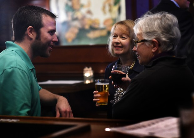 Rep. Jenifer Loon, center, and former Rep. Phyllis Kahn celebrate with Brandon Griffin, left, of St. Paul with a few drinks at O'Gara's after passage in the House of Loon's bill allowing Sunday liquor sales on Feb. 20, 2017. (Pioneer Press: Scott Takushi)