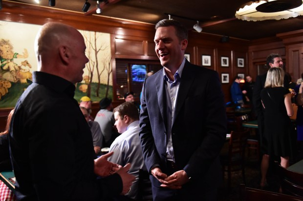 Speaker of the House Kurt Daudt, right, chats with Danny O'Gara, owner of the St. Paul restaurant and bar bearing his name, as House members and staffers celebrate with a few drinks at O'Gara's after passage in the House of Rep. Jenifer Loon's bill allowing Sunday liquor sales, Feb. 20, 2017. (Pioneer Press: Scott Takushi)