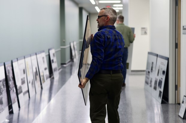 Larry Hutchings of Museology prepares 33 photo panels depicting the National Guard's history in Stillwater, from 1840 to the present, for mounting on the walls of the new Stillwater Armory, Feb. 27, 2017. (Pioneer Press: Scott Takushi)