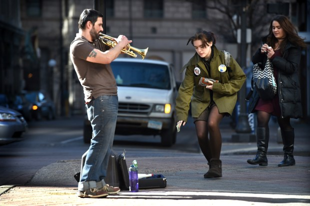 Demiano Cabrera of St. Paul plays his trumpet in a patch of sunlight as temperatures climb into the 50s on Wabasha and 5th Street on Friday, Feb. 17, 2017. He said he had to learn how to play with his right hand after his left arm was amputated from the elbow down due to a health problem. He picked up the trumpet nine years ago and taught himself how to play. He said he doesn't read music, he plays by ear. (Pioneer Press: Jean Pieri)