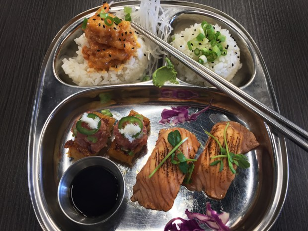 (Top left-- clockwise:) Shrimp, Salmon and Spicy Tuna on Crispy Rice at PinKU Japanese Street food. (Pioneer Press: Nancy Ngo)