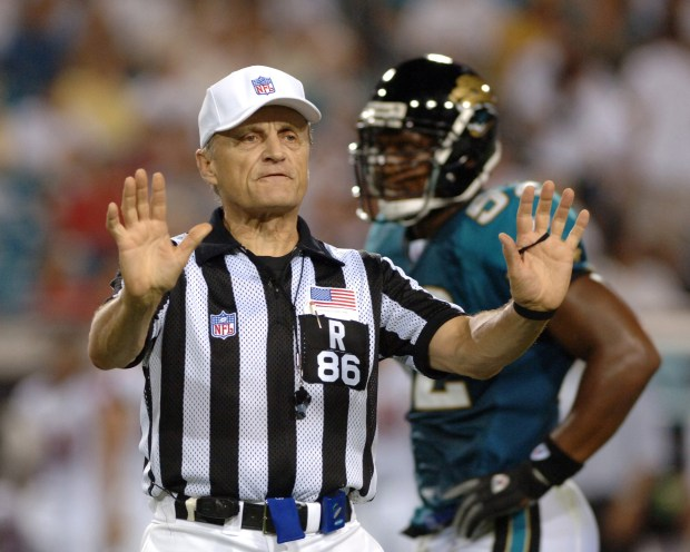 NFL referee Bernie Kukar signals a penalty in a pre-season game August 25, 2005 in Jacksonville. (Photo by Al Messerschmidt/Getty Images)