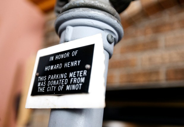 A plaque dedicating the parking meter to Howard Henry that was donated from the city of Minot. (Jesse Trelstad/Grand Forks Herald)