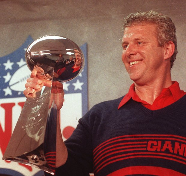 ** FILE ** New York Giants head coach Bill Parcells shows off the Super Bowl trophy after his team beat the Buffalo Bills 20-19 in Tampa, Fla., in this Jan. 28, 1991 file photo.  Parcells retired from coaching Monday, Jan. 22, 2007, leaving the Dallas Cowboys after four seasons and ending a stellar career that featured three Super Bowl appearances and two championships. (AP Photo/Mark Lennihan)
