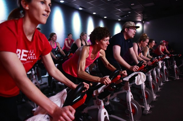 Riders take part in a charity fundraiser at CycleBar, one of the new businesses in CityPlace, on Sunday, Feb. 26, 2017. Almost one-third of the CityPlace retail locations are services, including a cooking school, exercise studio, bank, nail salon, barbershop and medical offices. (Scott Takushi / Pioneer Press)