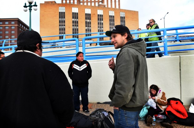 Matt Horn, right, talks to homeless people, including Russell Crow Ghost, 27, at left in baseball cap and his brother, Dakota Crow Ghost, 24, standing at center, along the Mississippi River in downtown St. Paul on Wednesday, Feb. 22, 2017. Horn, a program manager for homeless services at People, Incorporated, and outreach worker Katie Kennedy were trying to connect unsheltered adults to services in St. Paul. (Pioneer Press: Jean Pieri)