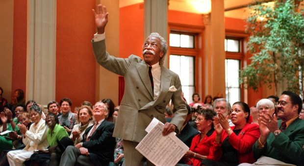 Gordon Parks acknowledges the applause of the audience during a Feb. 1998 concert at St. Paul's Landmark Center, where he performed his original compositions with the St. Paul Civic Symphony. The event, which drew 2,000 people, was presented by the Minnesota Museum of American Art as part of the unveiling of the exhibition ``Half Past Autumn: The Art of Gordon Parks.'' Joe Rossi / Pioneer Press