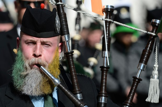 A bagpiper wears a beard in the colors of the Irish national flag during the St. Patrick's Day Parade in Munich, Germany, on Sunday , March 12, 2017. (Andreas Gebert/dpa via AP)
