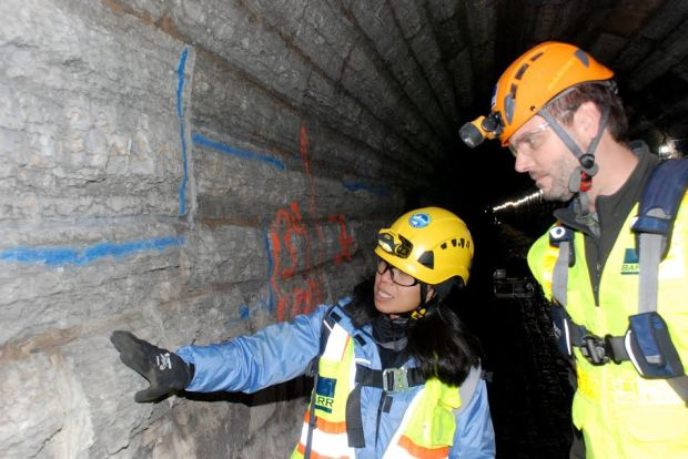 Anna Eleria, a planner with the Capitol Region Watershed District, inspects limestone and mortar in the Trout Brook Storm Sewer System in 2017. Courtesy of Capitol Region Watershed District.