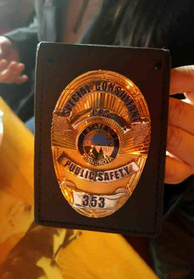 Two members of Minnesota Community Policing Services Foundation Inc. flashed ID cards, and a badge, to a manager at Joe's Crab Shack in Roseville, allegedly confusing him enough to think they might be police. No charges were brought, but the investigation led to charges in another matter. (Photo courtesy/ Roseville police department).