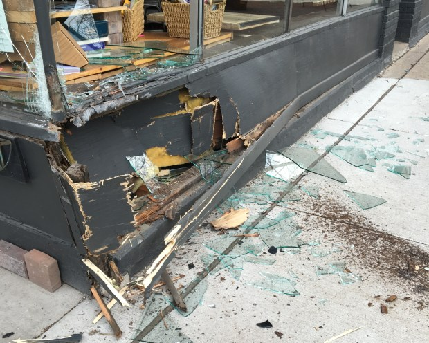 The front wall of Groundswell coffee shop is damaged after two cars collided Thursday, April 13, 2017, at Thomas and Hamline and one of them struck the wall. (Courtesy of Megan Greulich)