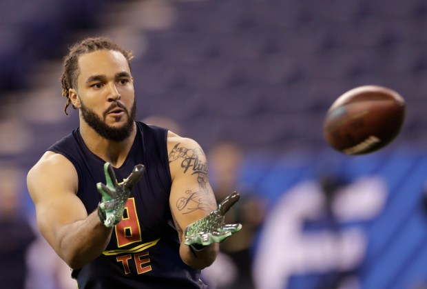 Virginia Tech tight end Bucky Hodges runs a drill at the NFL football scouting combine Saturday, March 4, 2017, in Indianapolis. (AP Photo/David J. Phillip)