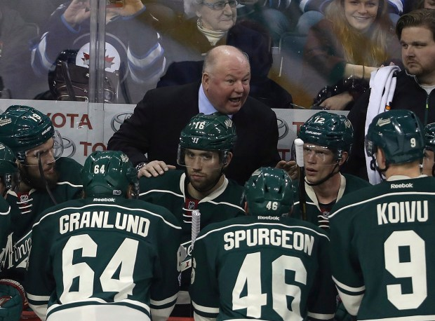 "FILE - In this March 19, 2017, file photo, Minnesota Wild coach Bruce Boudreau speaks to his team during a timeout in the first period of an NHL hockey game against the Winnipeg Jets in Winnipeg, Manitoba. Longtime coach and former player Bruce Boudreau has connections in some way to every playoff team, some closer than others. ""There's a lot of pride in players that you coached,"" Boudreau said .(Trevor Hagan/The Canadian Press via AP, File)"