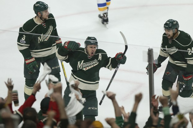 Minnesota Wild's Zach Parise, center, shouts in celebration after scoring a goal against the St. Louis Blues' during the second period of Game 2 of an NHL hockey first-round playoff series Friday, April 14, 2017, in St. Paul, Minn.  (AP Photo/Stacy Bengs)