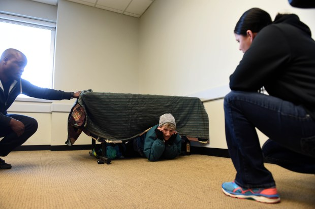 St. Paul Police Officers LaMichael Shead, left, and Jessica Stiffarm talk with actress Carolyn Levy, playing the part of a homeless, confused woman, during a crisis intervention team training session which the St. Paul Police Department and Hamline University are collaborating on, April 19, 2017 in St. Paul. Levy is a professor of theater and also director of the Making Waves Social Justice theater program. Scott Takushi / Pioneer Press